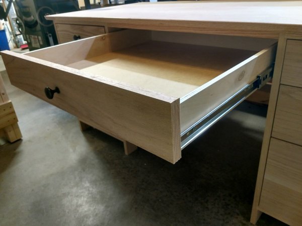 What needs to be done before installing the drawer slide